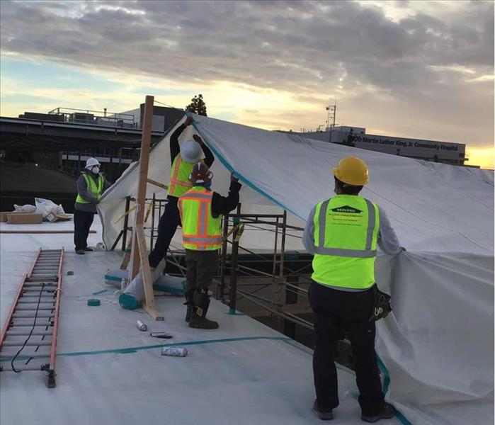 commercial water damage clean-up roof tarping near me compton